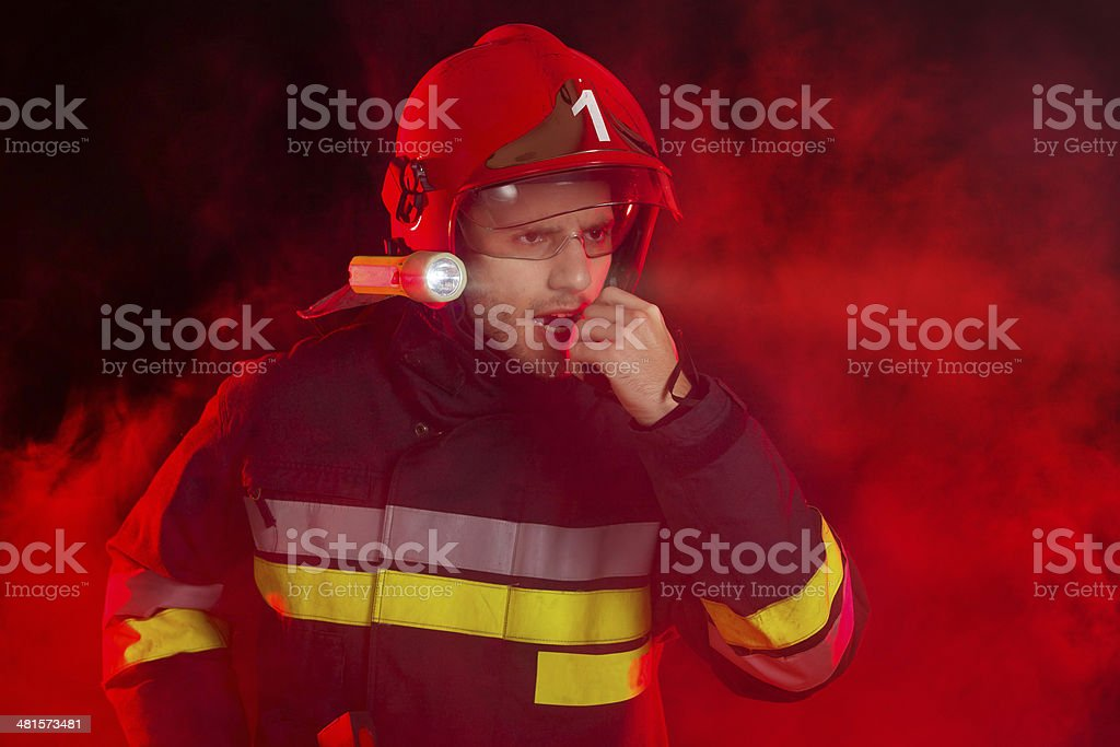 Firefighter in action using a walkie-talkie stock photo