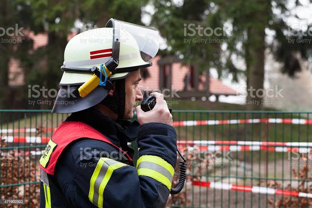 Firefighter in action with celluar stock photo