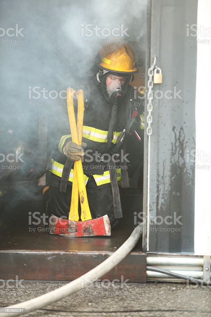 Firefighter in fire smoke royalty-free stock photo