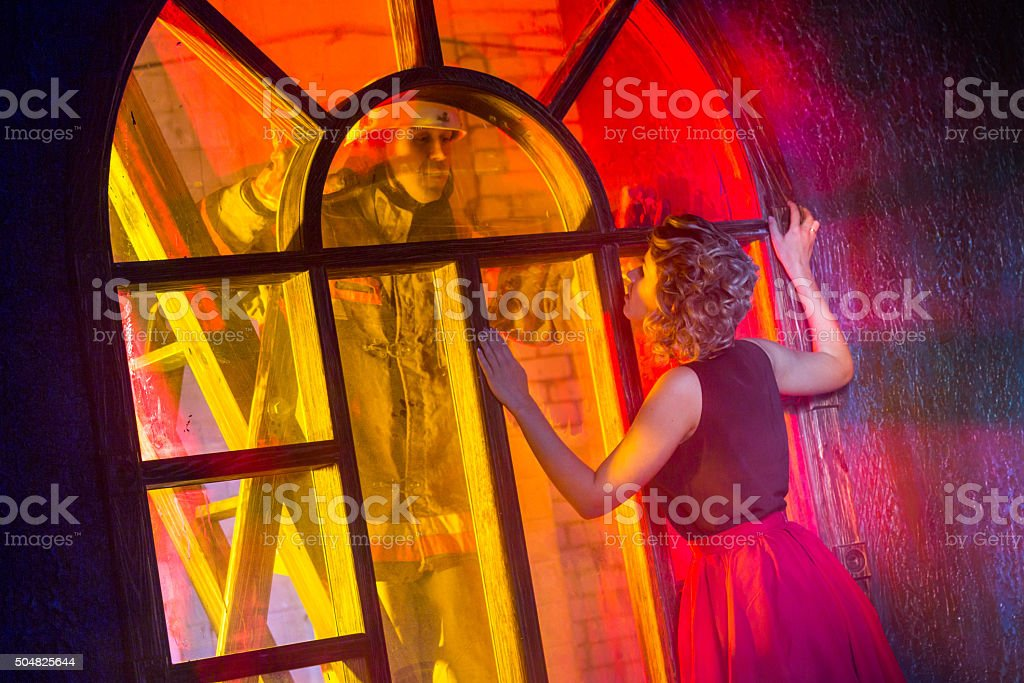 Firefighter Is Come To Rescue Woman stock photo