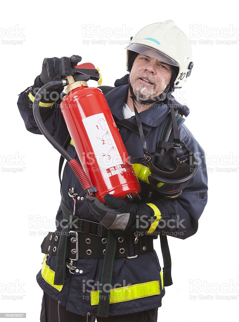 firefighter is showing a extinguisher royalty-free stock photo