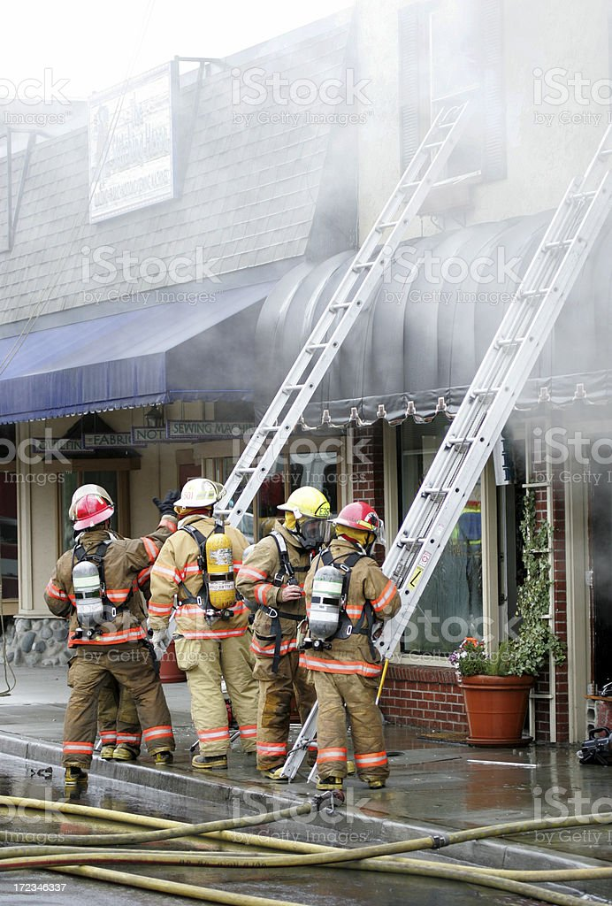 firefighter ladder teams stock photo