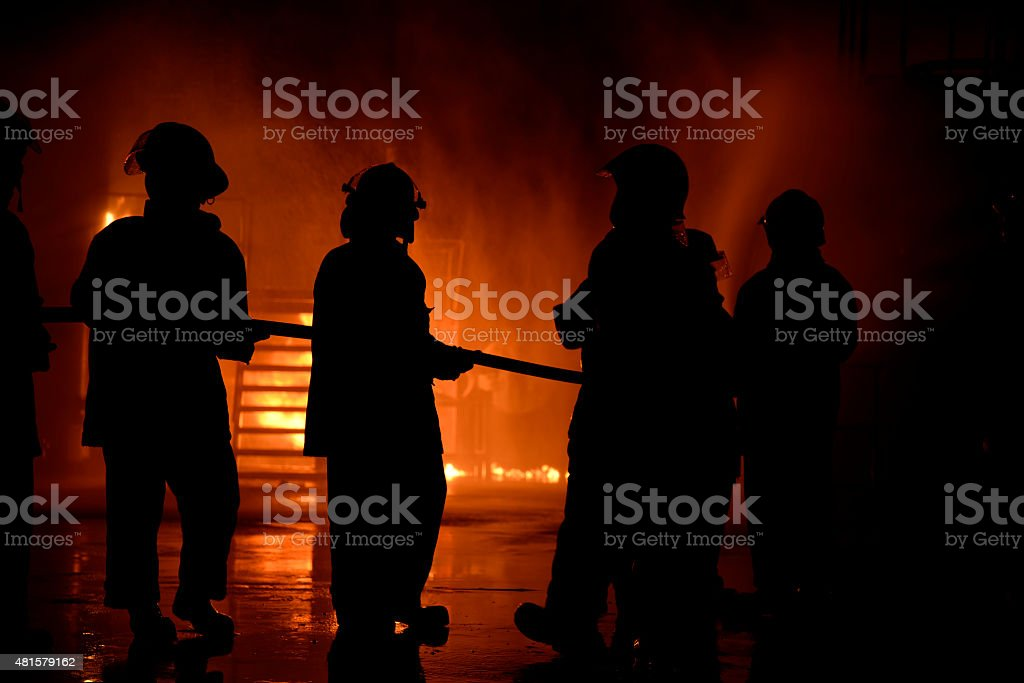 firefighter night industry. stock photo