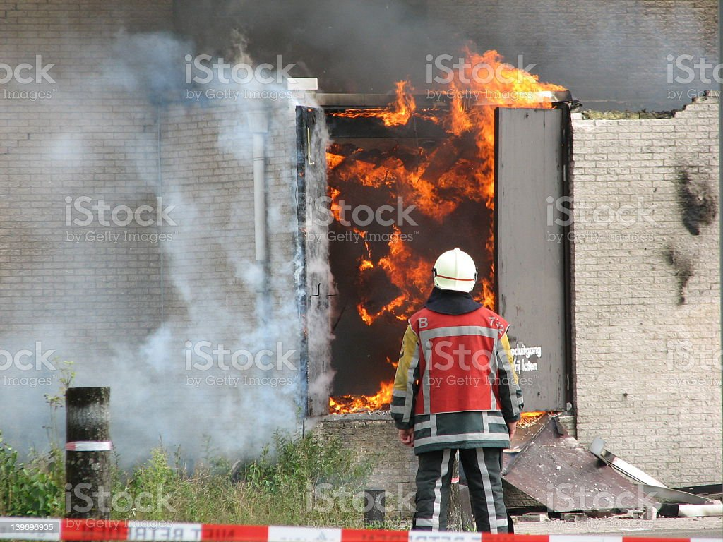 Firefighter observing fire stock photo