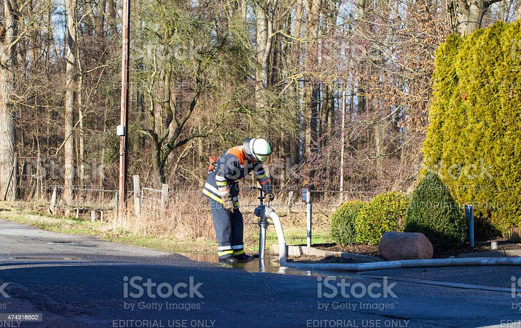 Firefighter on fire hydrants stock photo