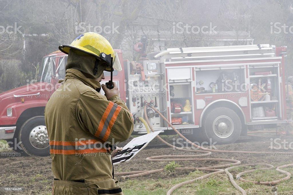 Firefighter on radio royalty-free stock photo