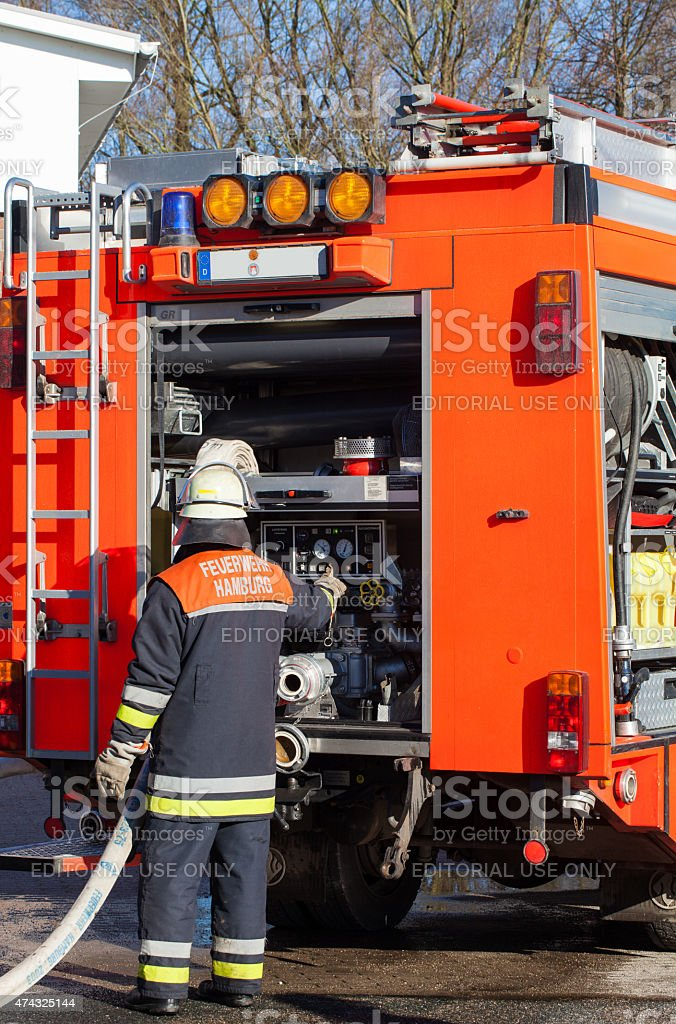 Firefighter operated at the fire truck the water aggregator stock photo