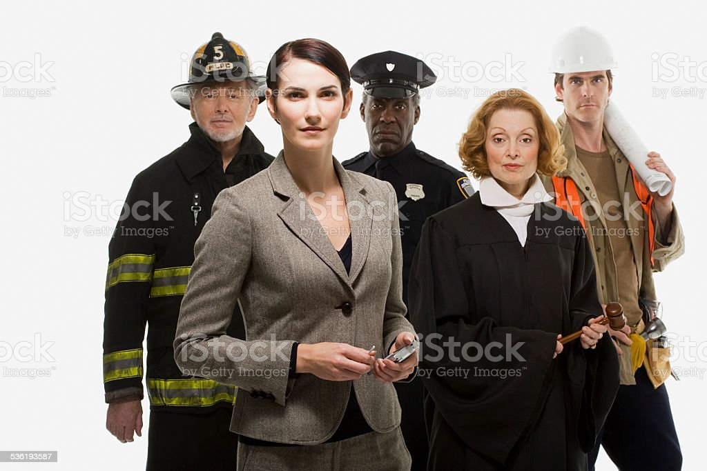 Firefighter police officer judge construction worker and businesswoman stock photo
