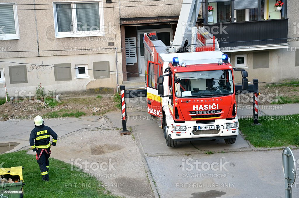Firefighter stand near the fire truck in action stock photo