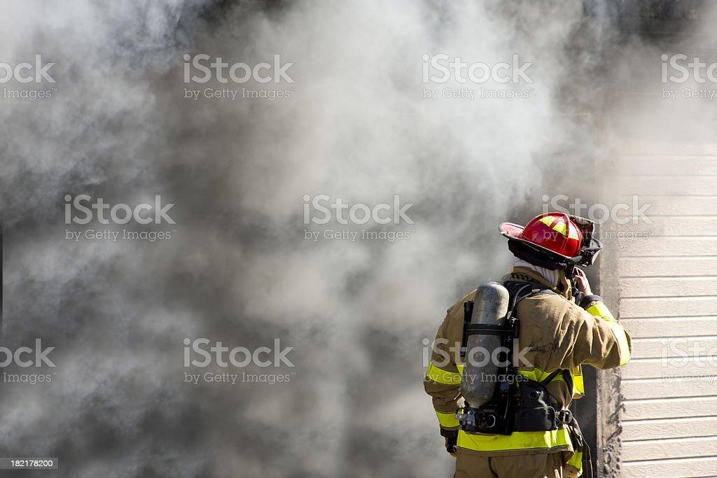 Firefighter Talking on Radio royalty-free stock photo