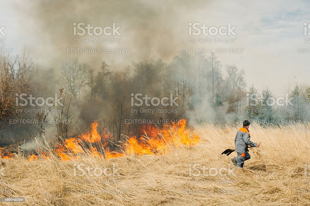 Firefighter try to suppress fire stock photo