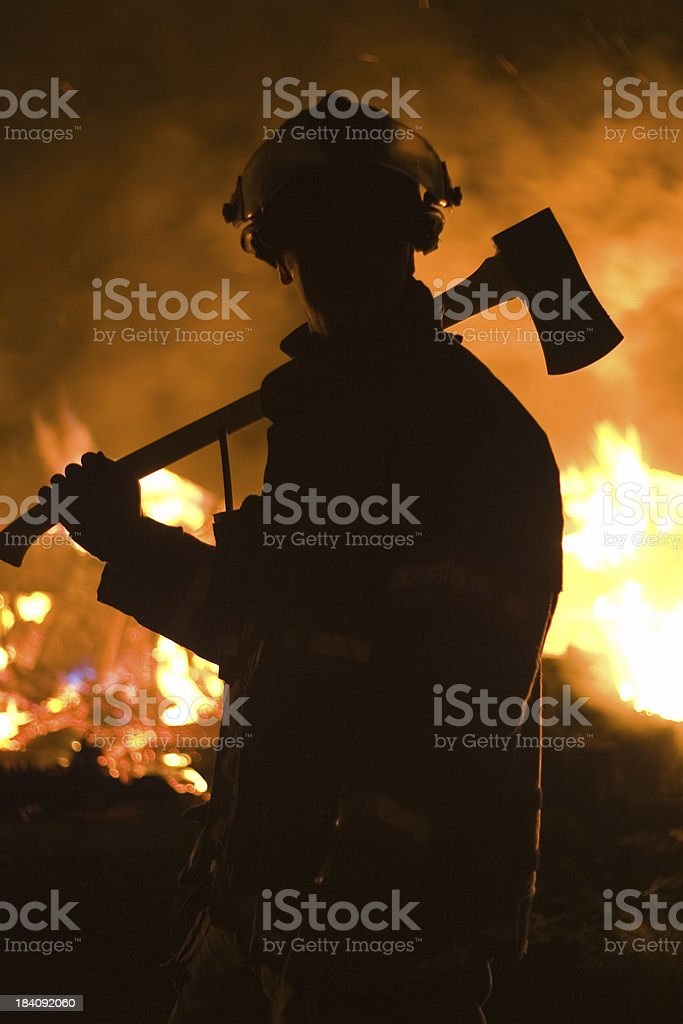 Firefighter with axe 2 stock photo
