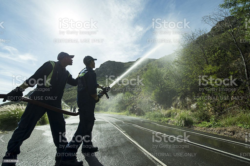 Firefighters against Table Mountain royalty-free stock photo