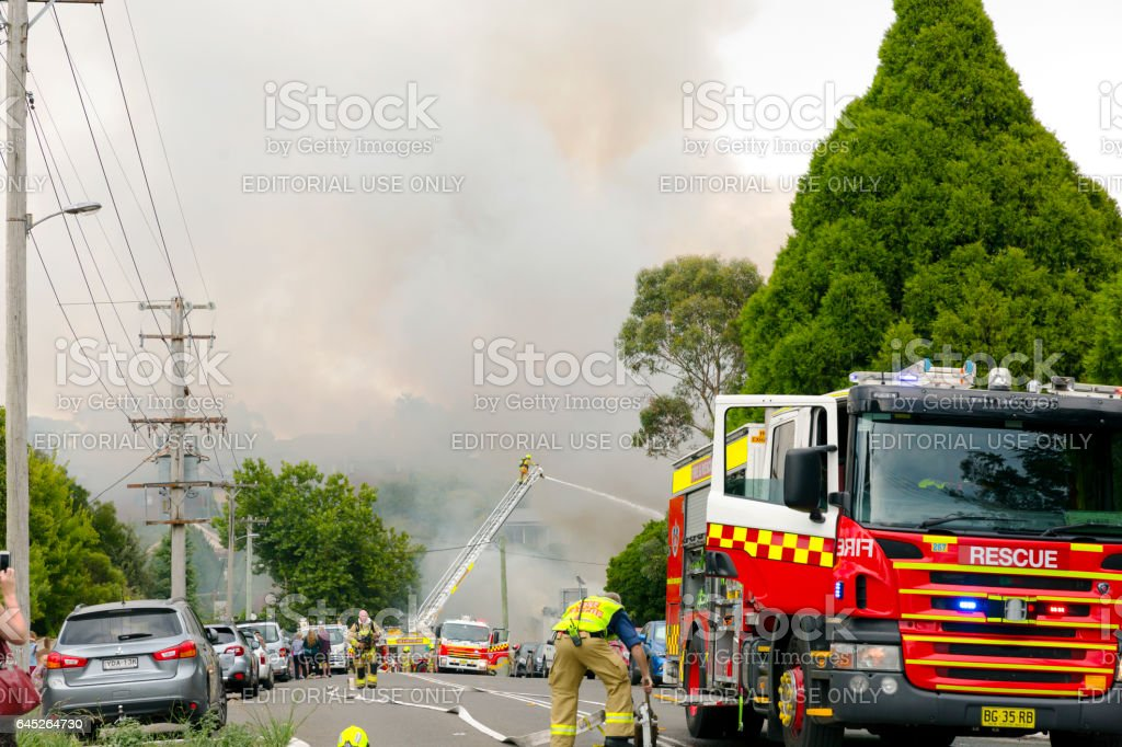 Firefighters and burning house, Blue Mountains Australia stock photo