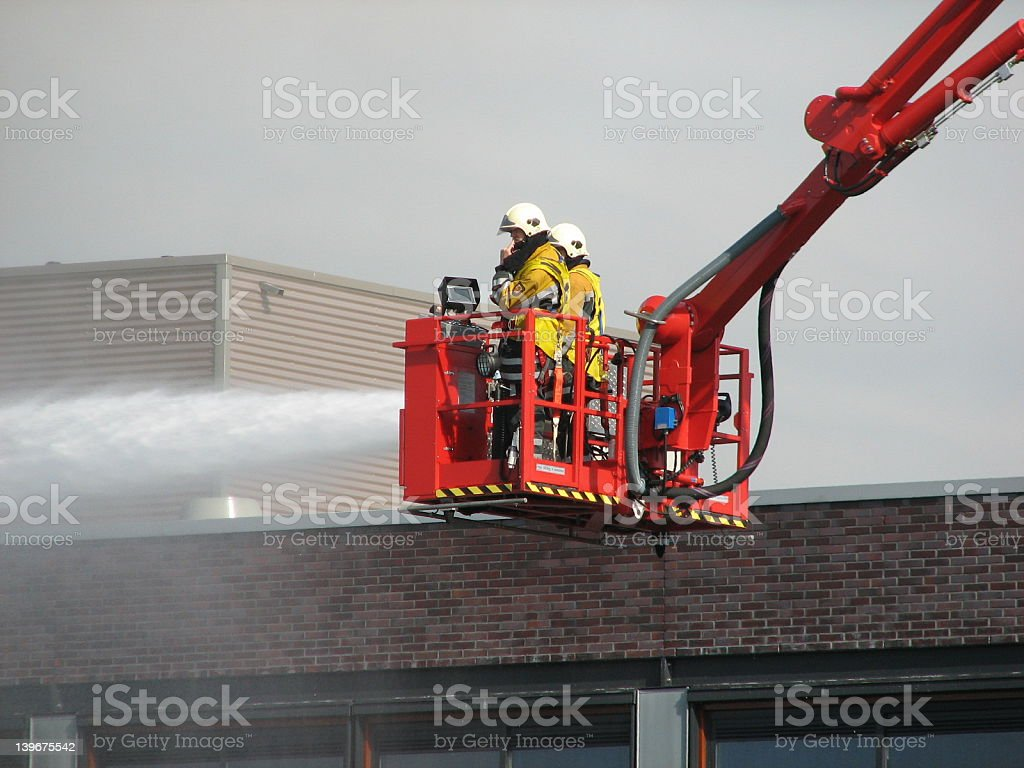 Firefighters at work stock photo