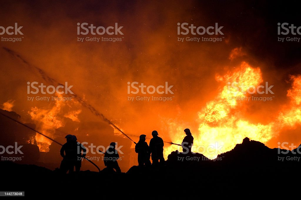 Firefighters at work royalty-free stock photo
