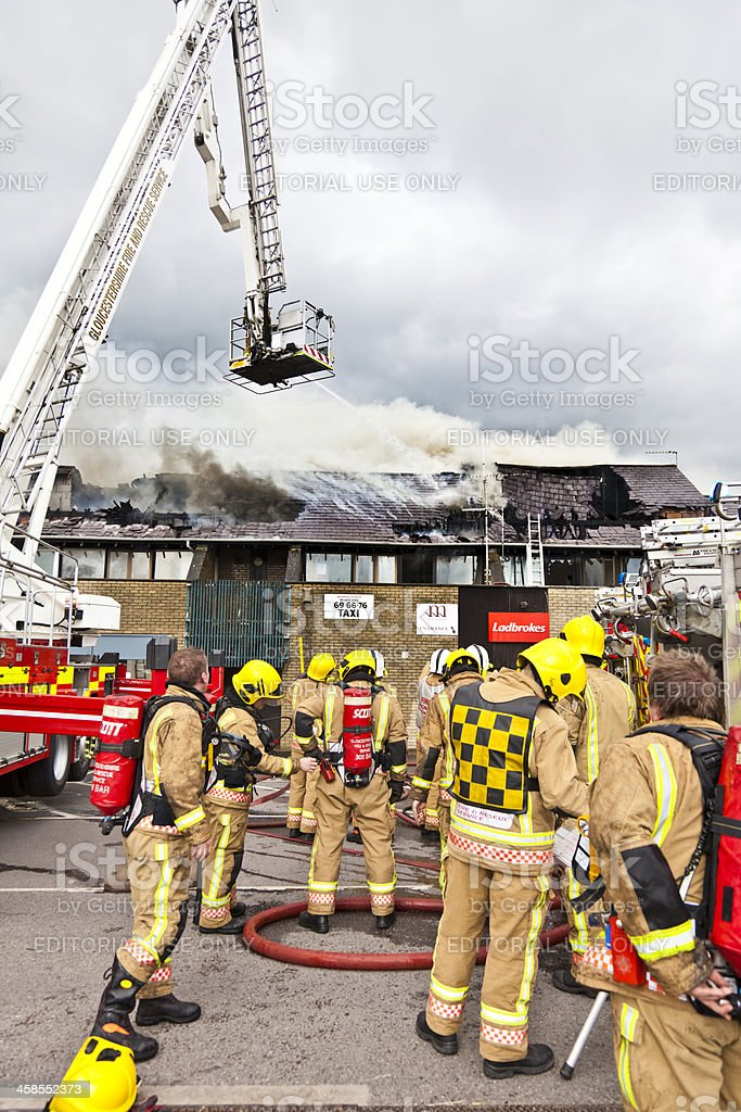 Firefighters attending a blaze royalty-free stock photo
