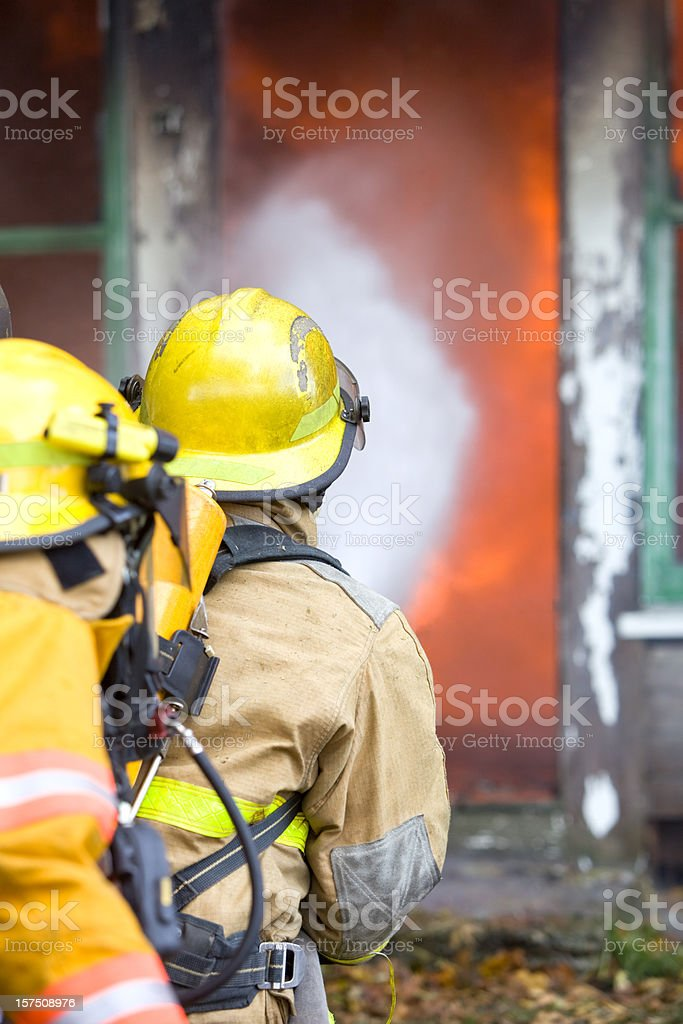 Firefighters Battling a House Fire royalty-free stock photo