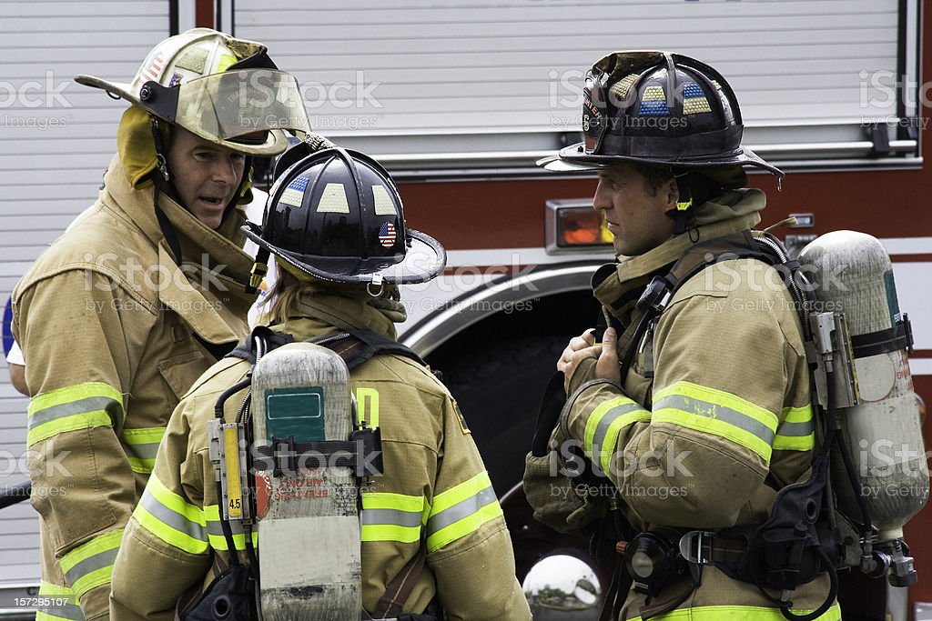 Firefighters Discuss Strategy stock photo