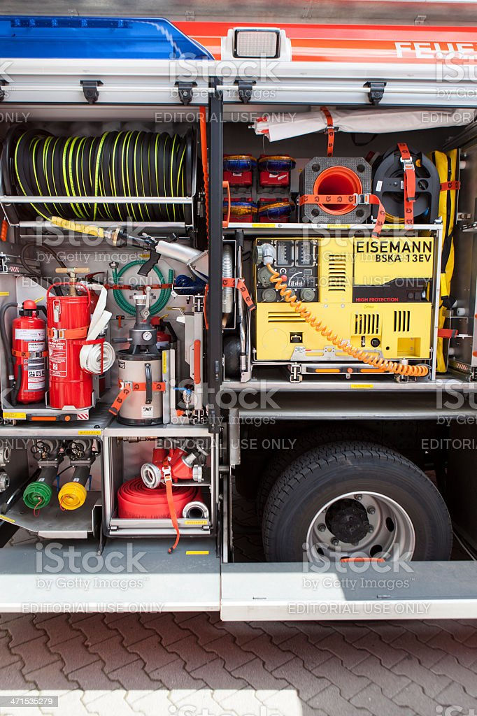 A fire engine of Feuerwehr Frankfurt am Main with open doors and...