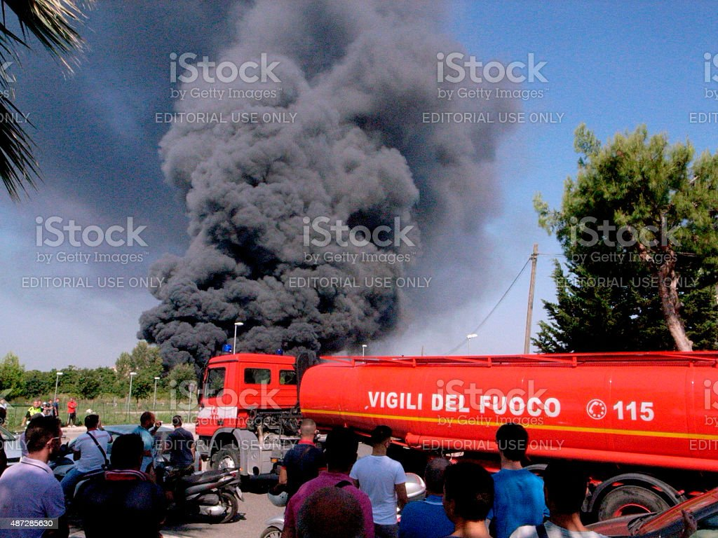 Firefighters extinguish the fire in territory named 'terra dei fuochi'. stock photo