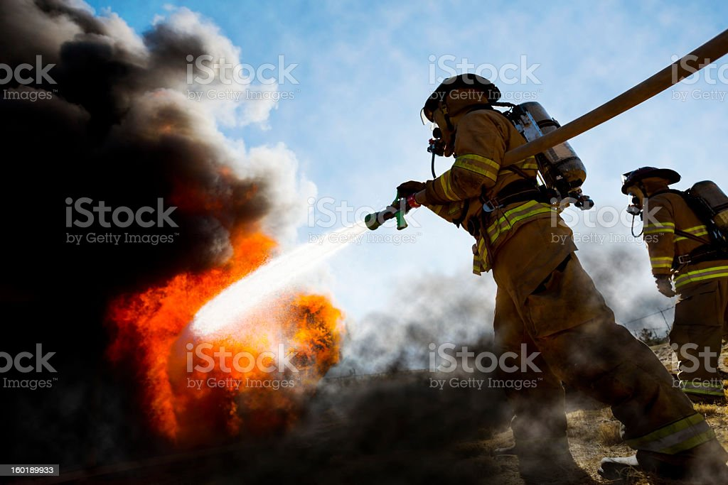 Firefighters Extinguishing House Fire royalty-free stock photo