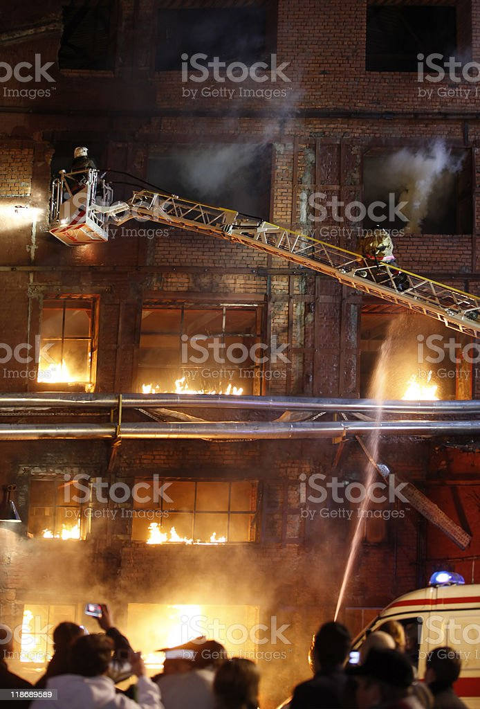 Firefighters fighting a fire royalty-free stock photo