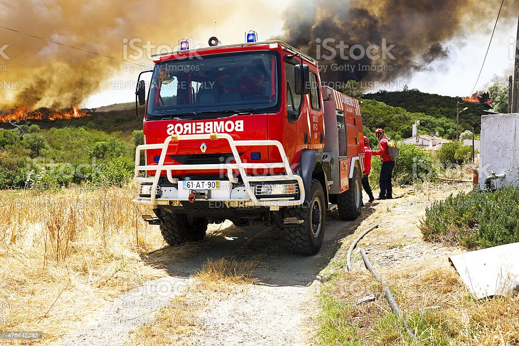 Firefighters fighting a huge bushfire royalty-free stock photo