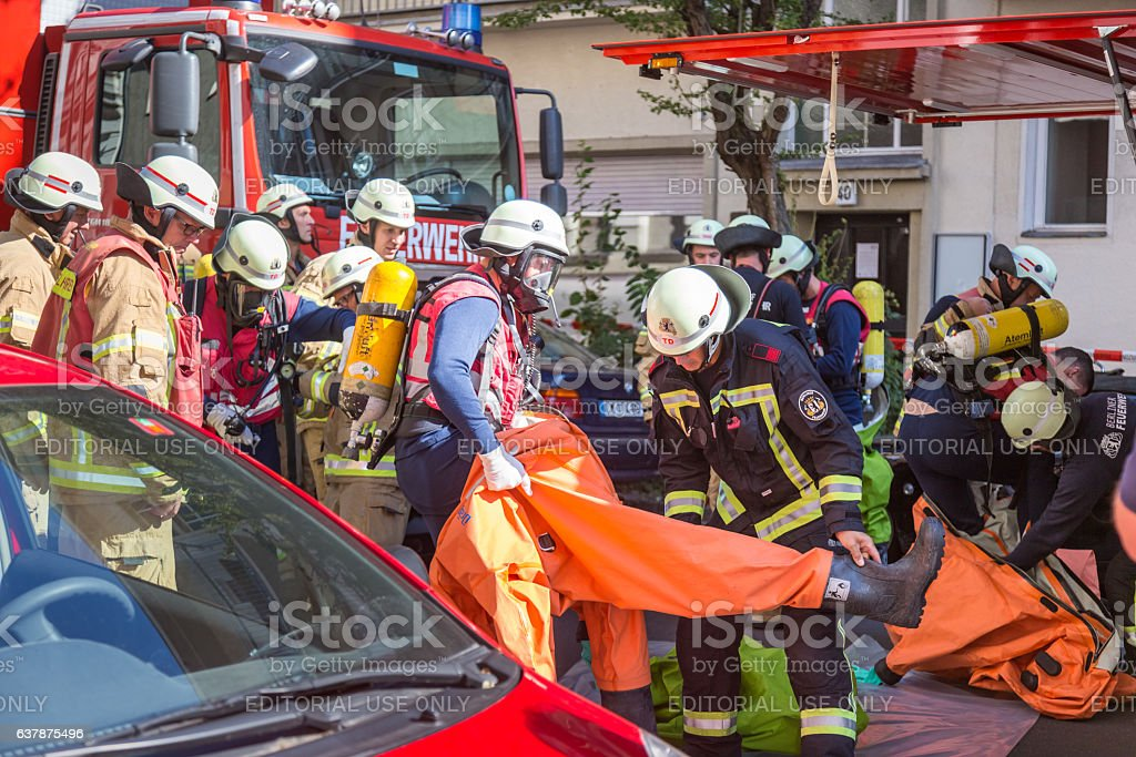 Firefighters getting ready to intervene on chemical accident location. stock photo