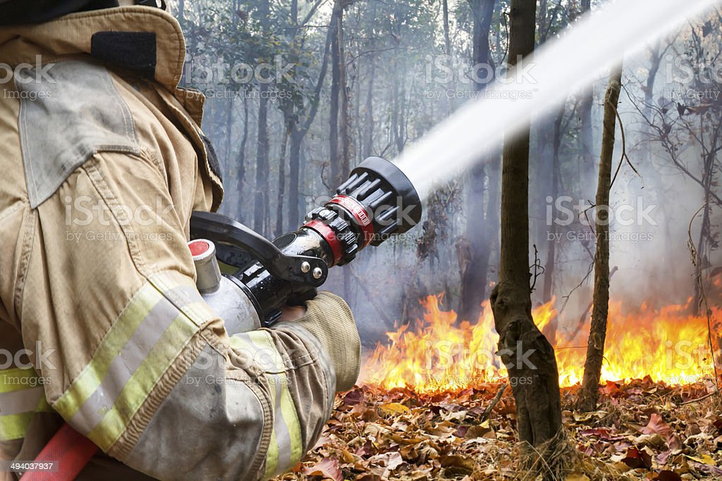 firefighters helped battle a wildfire stock photo