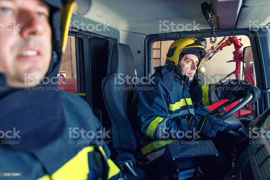 Firefighters in a truck stock photo