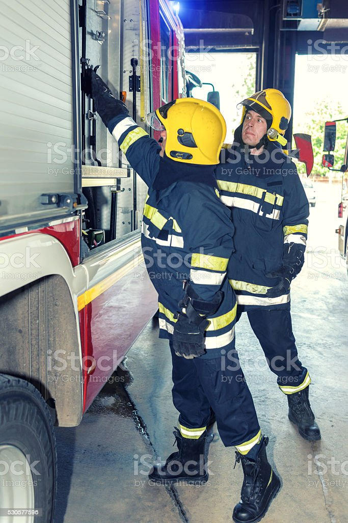 Firefighters in action stock photo