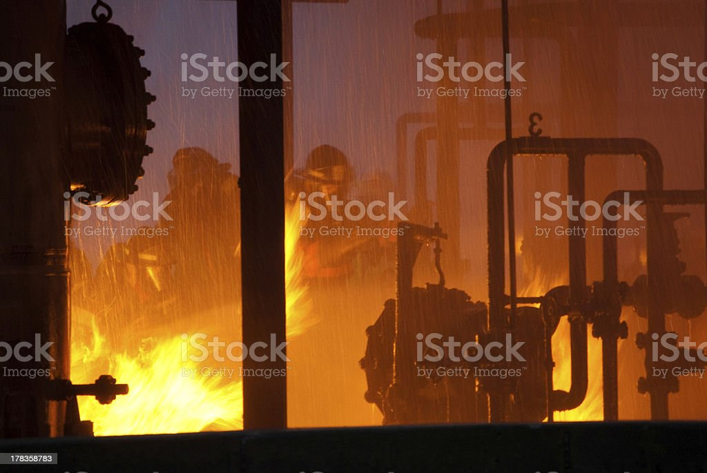 firefighters in industrial fire stock photo