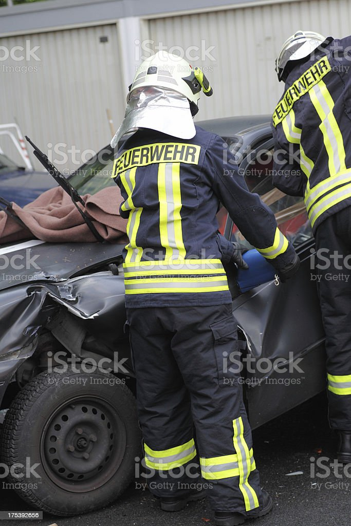 Firefighters removing door from car wreck stock photo