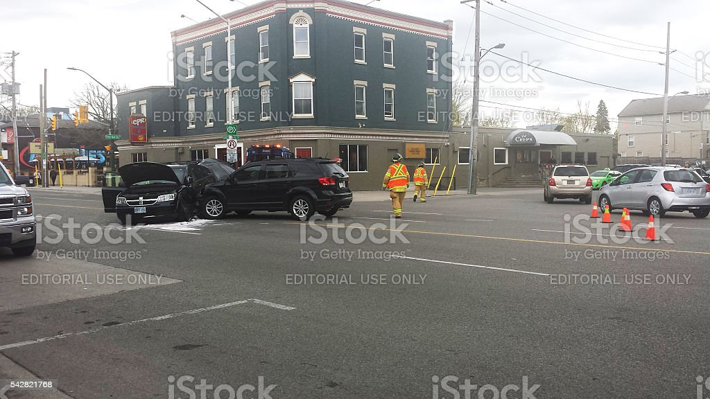 Firefighters respond to two vehicle accident with two car destroyed stock photo