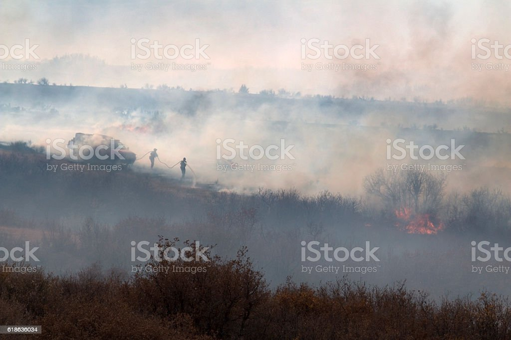 Firefighters spray Highlands Ranch Colorado Chatridge Fire wildfire smoke stock photo