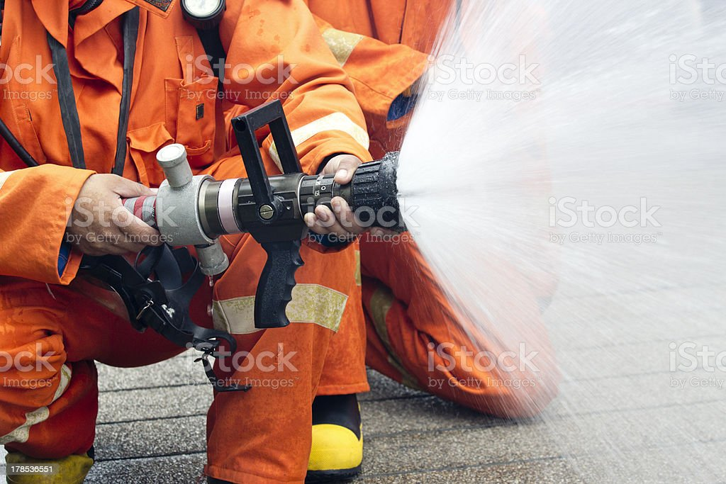Firefighters spray water royalty-free stock photo
