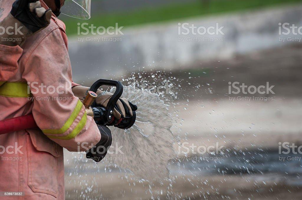Firefighters spray water stock photo