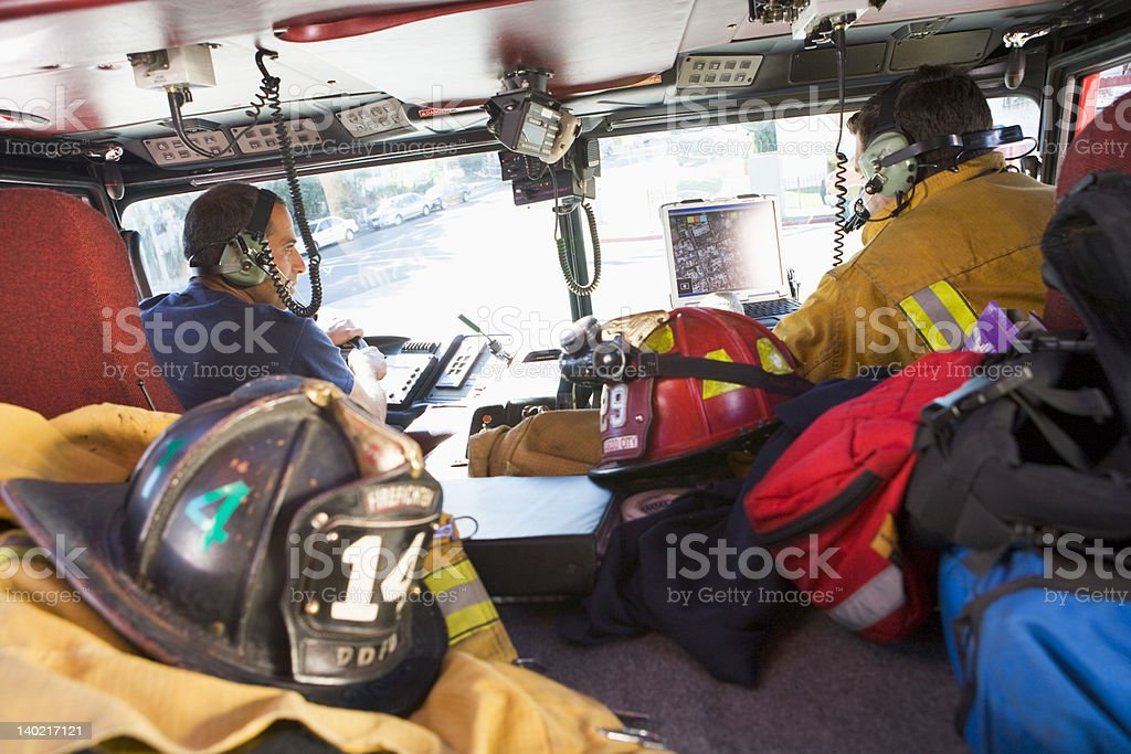 Firefighters travelling to an emergency stock photo
