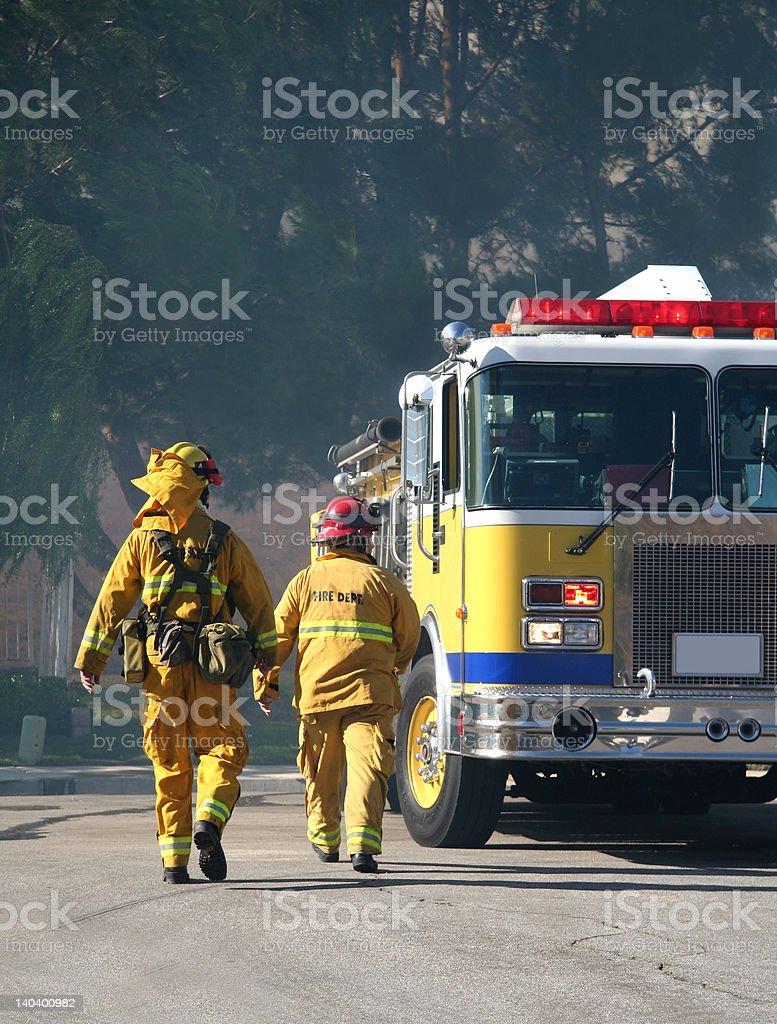 Los bomberos a foto de stock libre de derechos