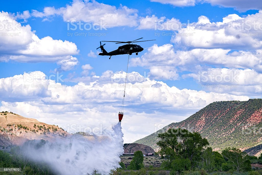 Firefighting Helicopter with Water Bucket stock photo