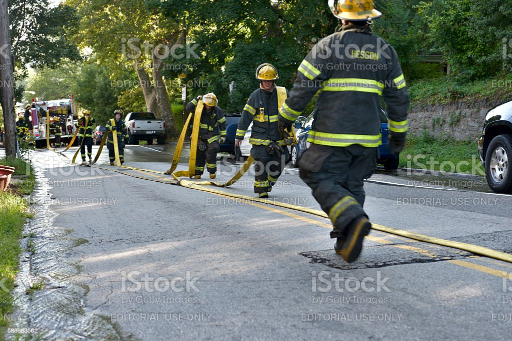 Firefigters battle fire under excessive heat warning in Philadelphia, PA stock photo