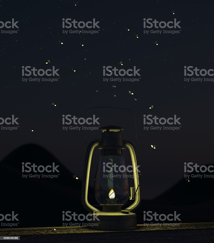 fireflies fly around the oil lamp stock photo