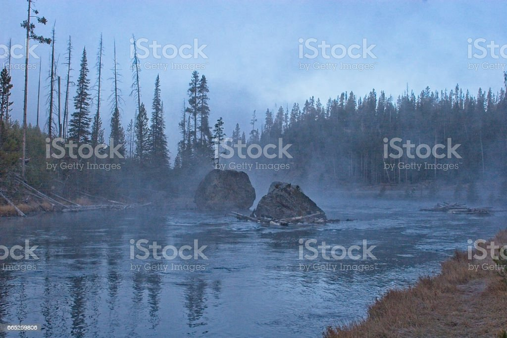 Firehole River at sunrise with geothermal hotsprings in Yellowstone National Park, Wyoming stock photo