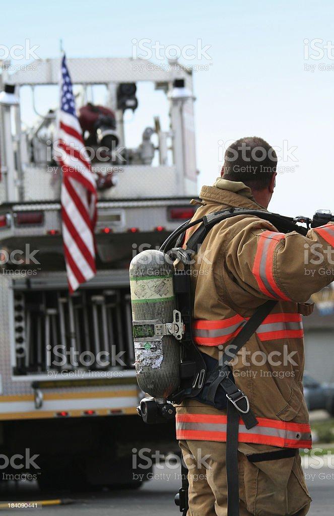 Fireman and Flag royalty-free stock photo