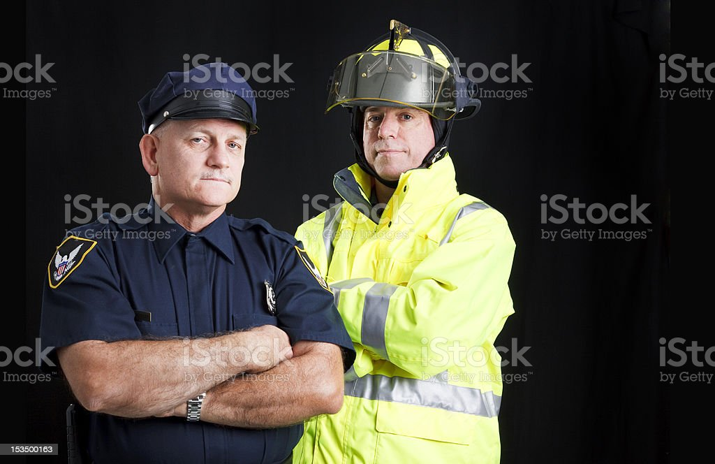 Fireman and Policeman with Copyspace royalty-free stock photo