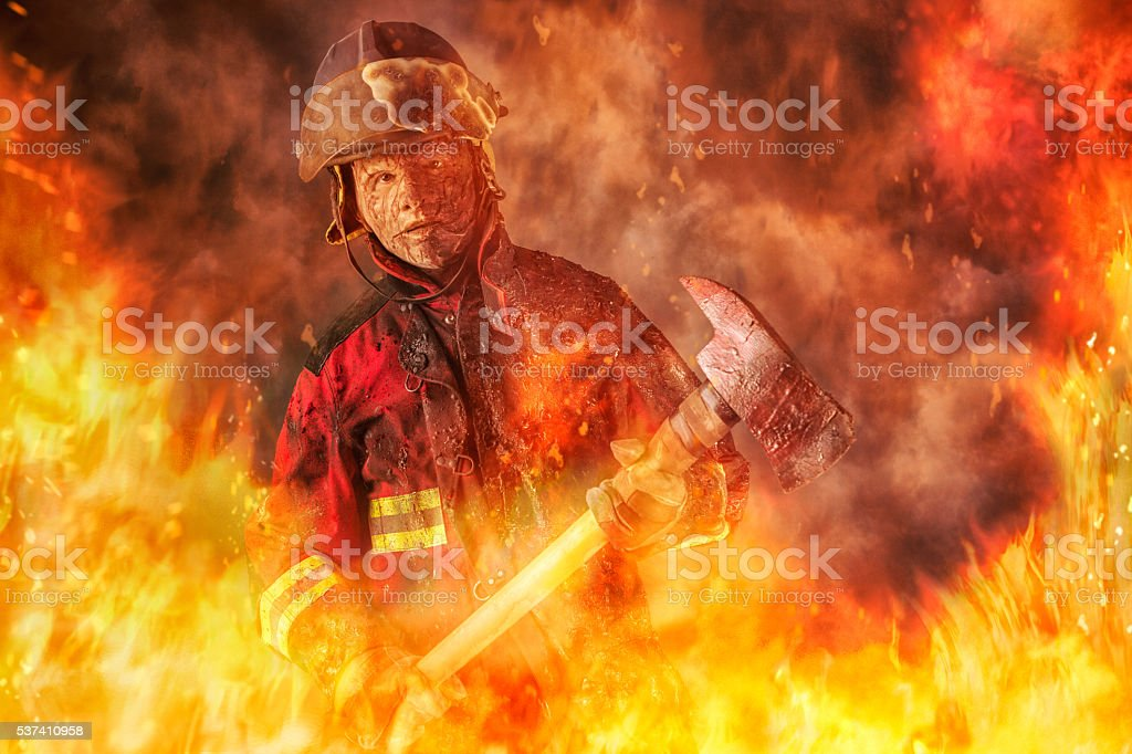 Fireman caught in a Fire stock photo