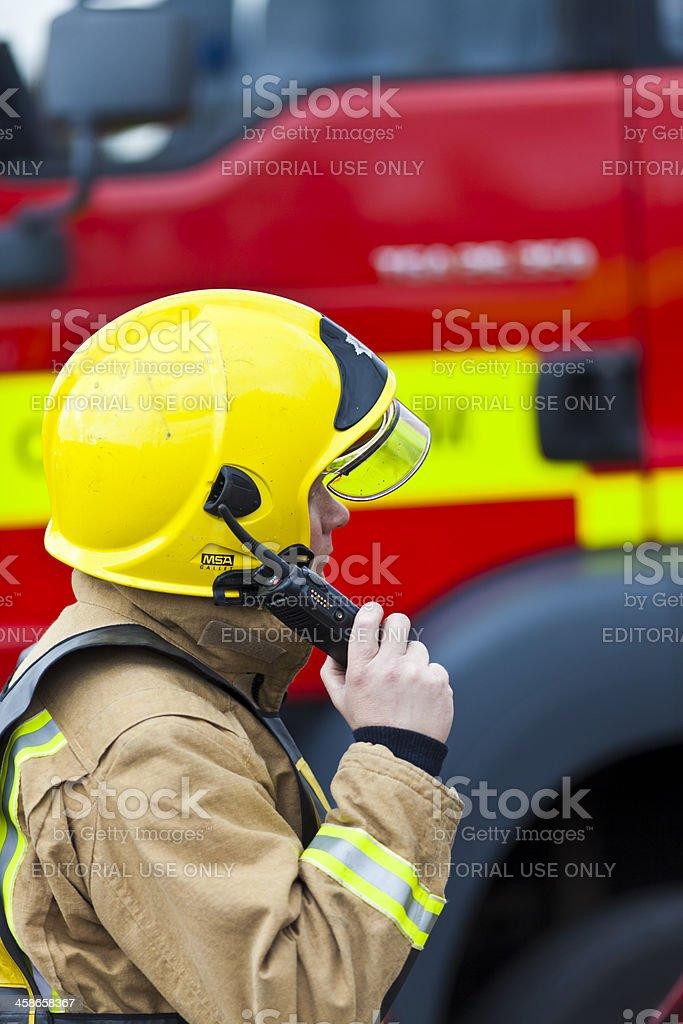 Fireman communicating on radio stock photo