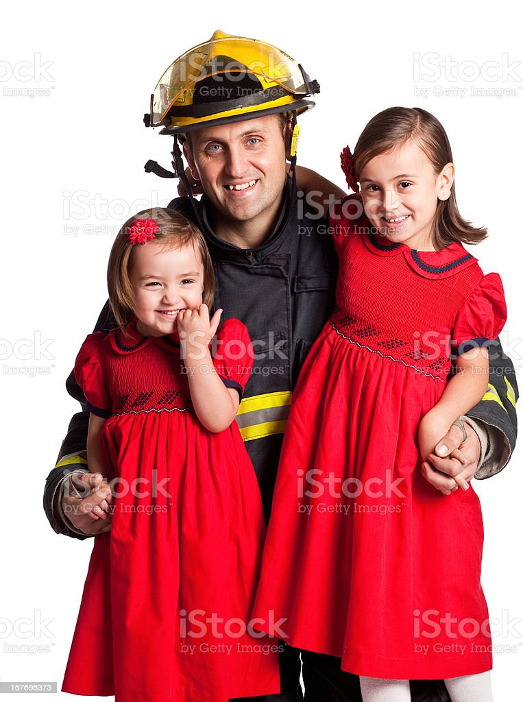 Fireman dad with his two daughters on white background. stock photo