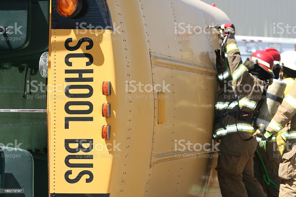 Fireman extricating students from School Bus royalty-free stock photo